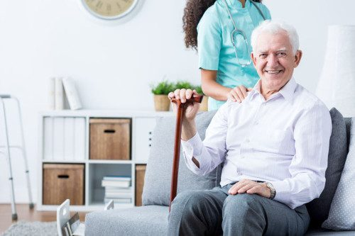 Happy senior disabled man and caregiver